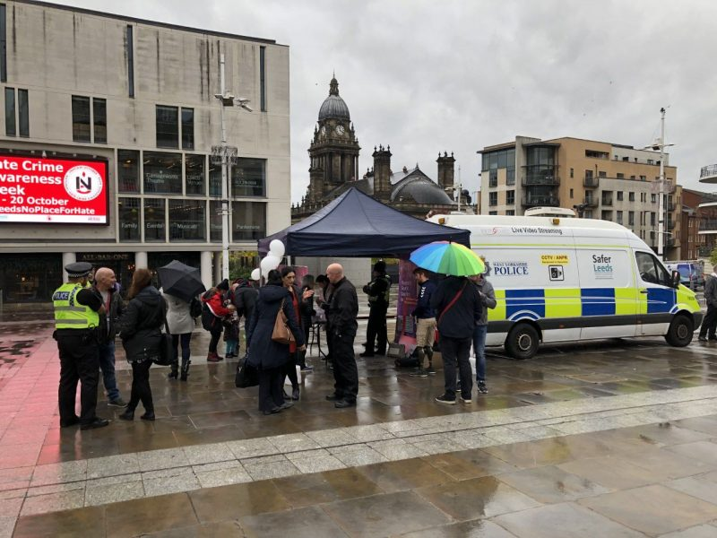 Members of the public and West Yorkshire Police at the launch of 'Hate Hurts' event for Hate Crime Awareness Week.