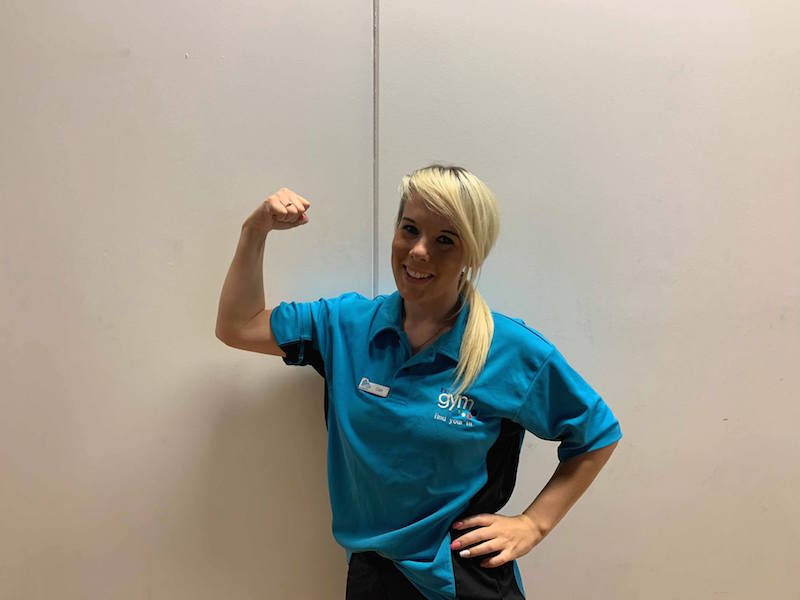 Cath Halstead flexing her arm