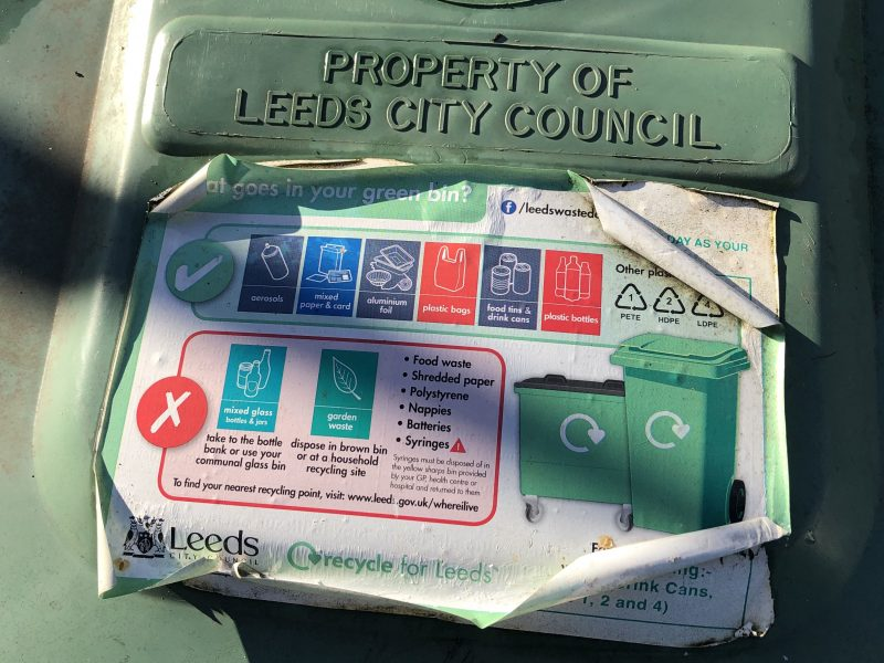 Leeds city council use stickers on the green bins to instruct households what can be recycled. This is an effort to reduce contamination.