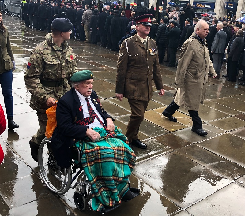 Elderly man in wheelchair in service uniform on Remembrance day 2018