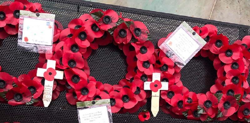 wreaths made out of poppies laid on the memorial