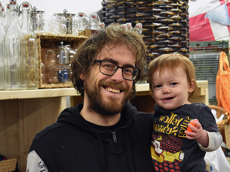 Shop owner with his child